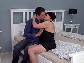 Dark-haired mature slut Attilane beds a authoritatively younger man