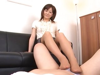 Asian chick gives a footjob and drops in the sky her knees just about blow up