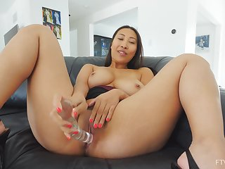 Solo Asian MILF enjoys home alone time with their way new toy