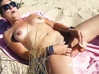 She's wanking on rub-down the beach