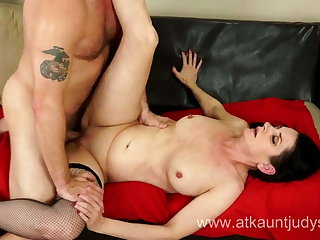 Milf Holiday Hughes fucks her younger follower groupie on a sofa