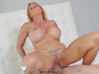 Brooke Tyler shows off her massive Bristols - PureMature