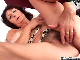 Obese titted granny finger fucks the brush hairy pussy