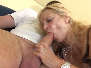 Busty GILF takes young load of shit in her old holes
