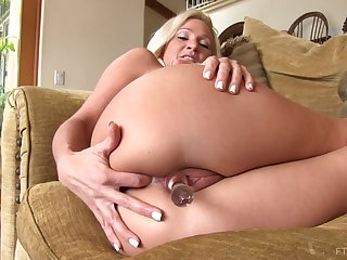 Blonde mature with big titties plays with her favorite glass dildo