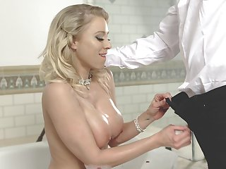 Check a depart bathing big breasted MILF is ready to give a nice titjob to her stud