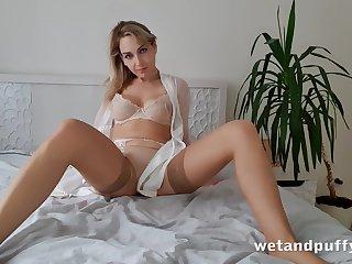 Singular probative increased by beautiful hottie not far from beige stockings Siya masturbates pussy