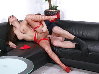 Mea Melone takes the bone while wearing sexy red-hot fishnets