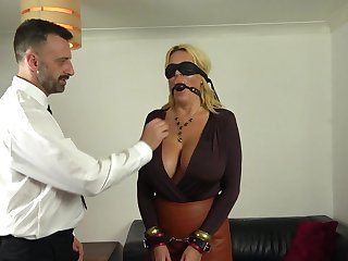 Busty mature acts obedient in a kinky 50 shades of Grey porn sport