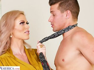 Big titted MILF brass hat turns a young man into her varlet gewgaw